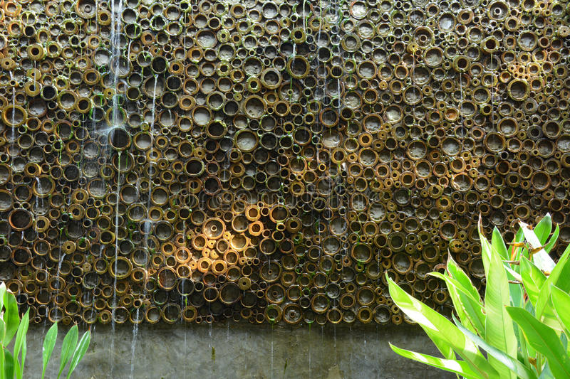 download abstract artificial waterfall wall made from bamboo stalks stock photo image