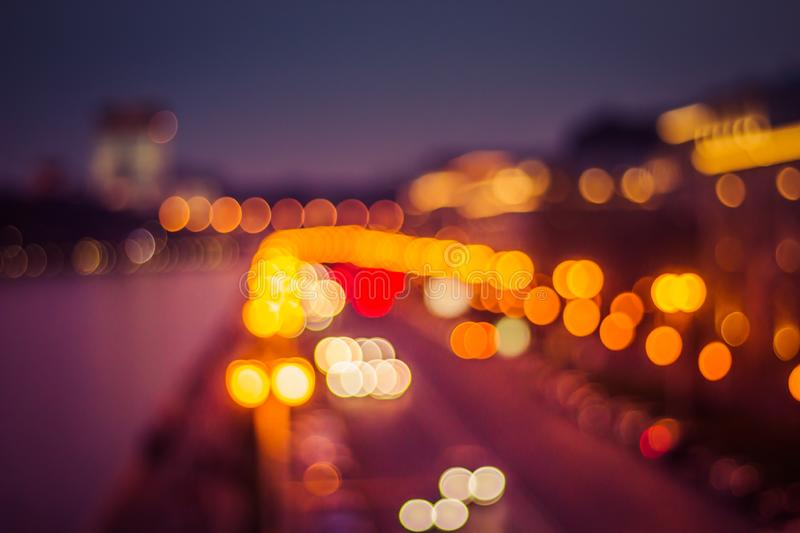Abstract artistic photo: blurry cityscape with streetlights stock photography