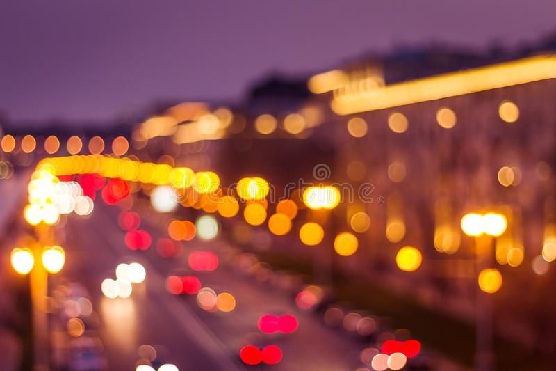 Abstract artistic photo: blurry cityscape with streetlights royalty free stock images