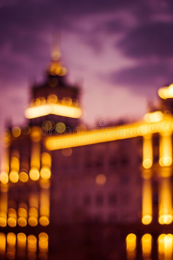 Abstract artistic photo: blurry cityscape with streetlights stock images