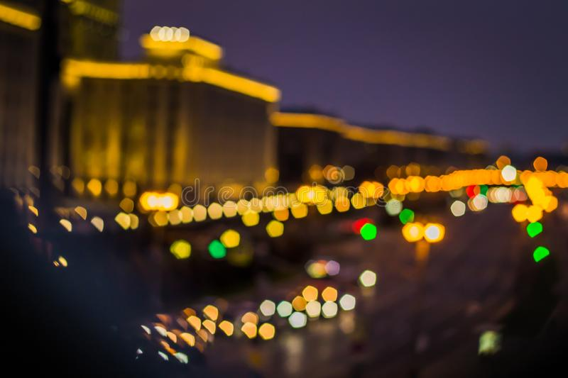 Abstract artistic photo: blurry cityscape with streetlights royalty free stock photos