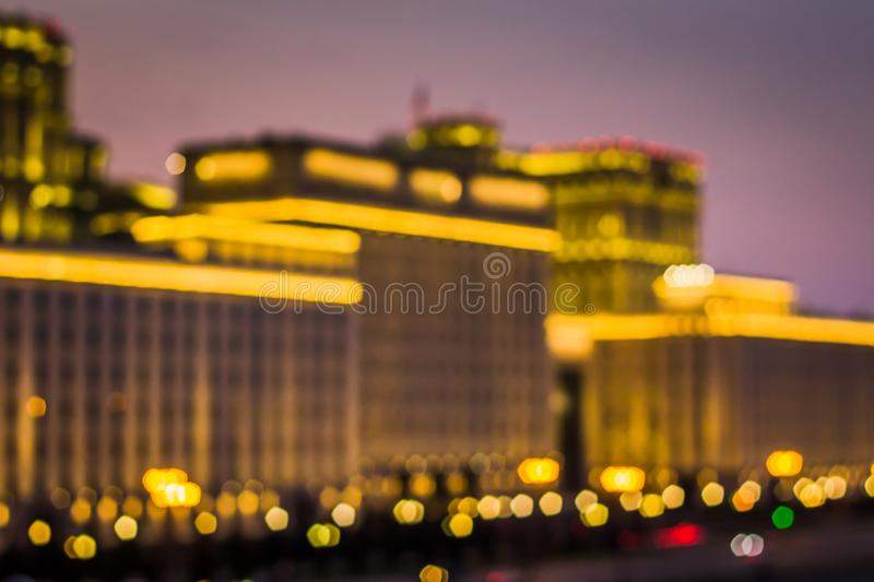 Abstract artistic photo: blurry cityscape with streetlights stock photo