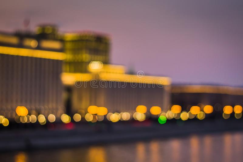 Abstract artistic photo: blurry cityscape with streetlights royalty free stock photography