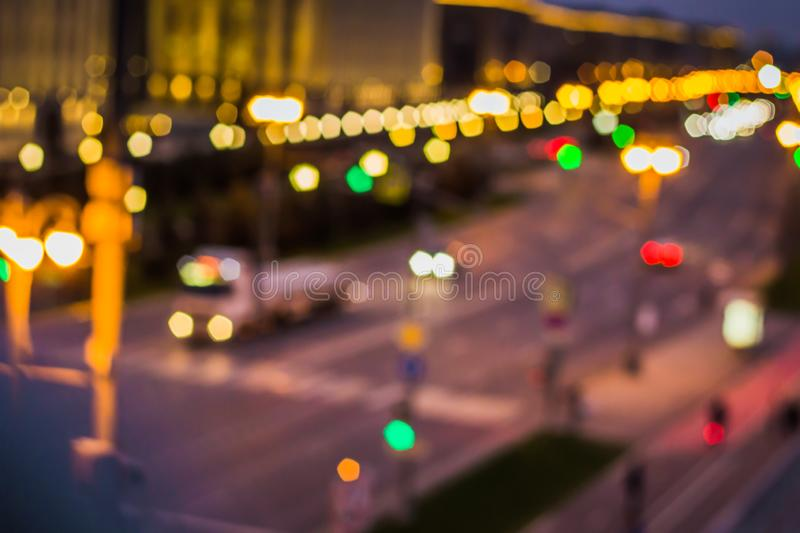Abstract artistic photo: blurry cityscape with streetlights royalty free stock photo