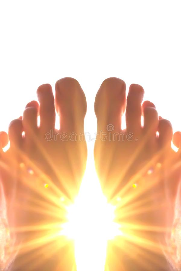 The sun through the toes. Abstract,background,beautiful,blue,body,bright,calm,concept,death,eternity,finger,fingers,god,heaven,human,isolated,light,love,nature stock photos