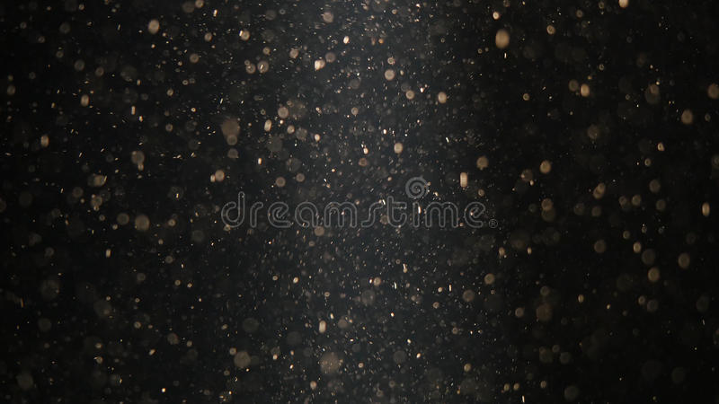 Abstract background with beautiful flickering particles. Underwater bubbles in flow with bokeh royalty free stock photography