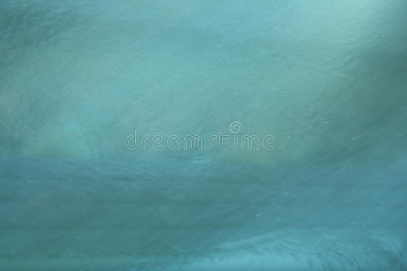 Abstract background in blue. Abstract textured background in blue
