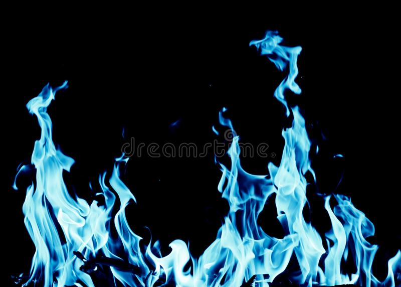 Abstract background of blue flame fire on black background stock image