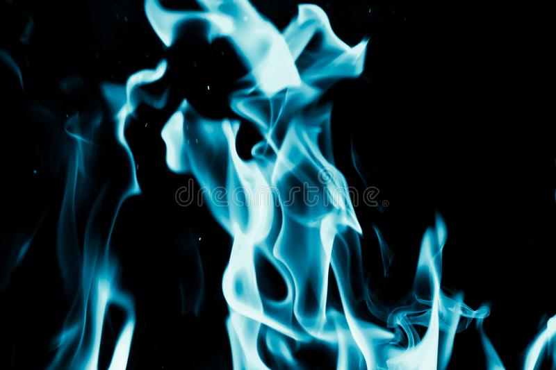 Abstract background of blue flame fire on black background stock images