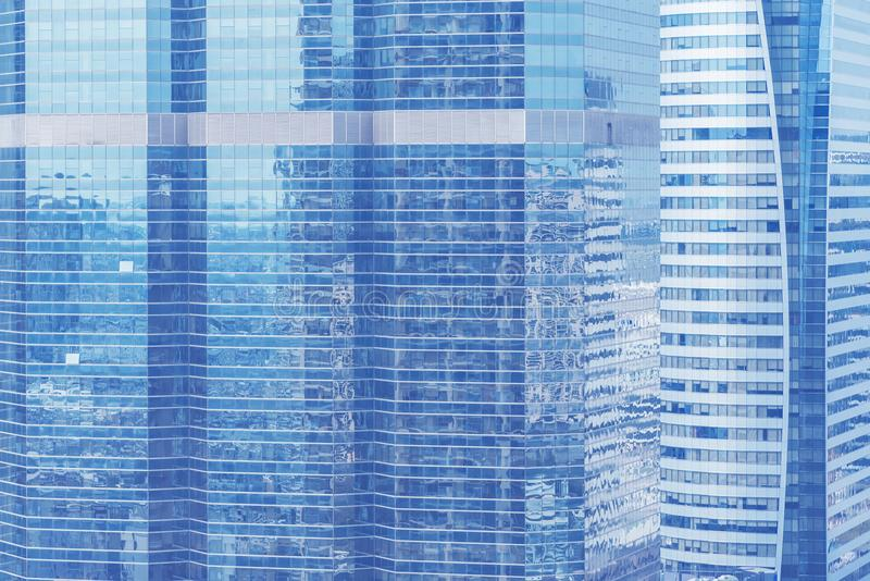 Abstract background from blue glasses window, high modern business building in city. Picture for add text message. Backdrop for d royalty free stock photo
