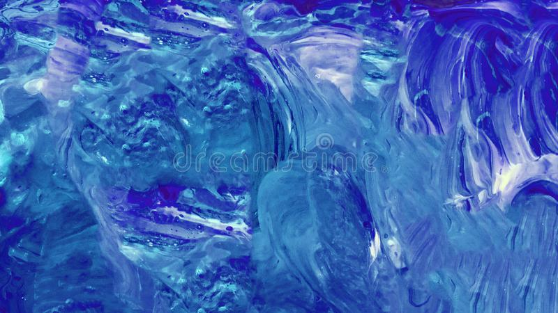 Abstract background of blue and white liquid stains with acrylic paint in the form of spots and waves. Neon fluid  watercolor royalty free stock photography