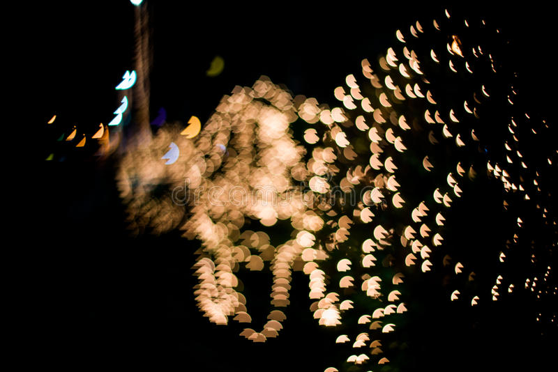 Abstract background with bokeh lights and stars stock photography