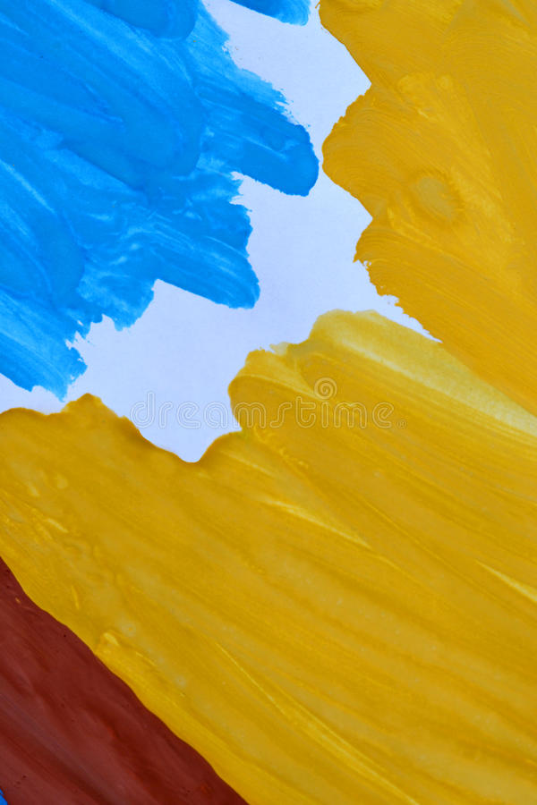 Abstract background brush strokes yellow, brown, blue ink white paper. Abstract background brush strokes yellow, brown, blue ink on white paper close-up royalty free stock image