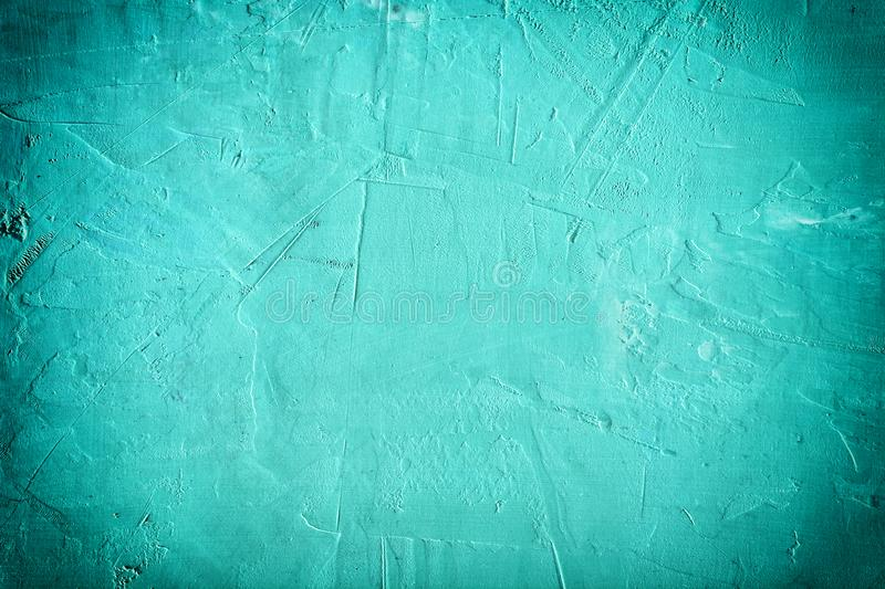Abstract background bumpy putty. Beautiful turquoise color, empty space with vignette. Texture of the plaster royalty free stock image