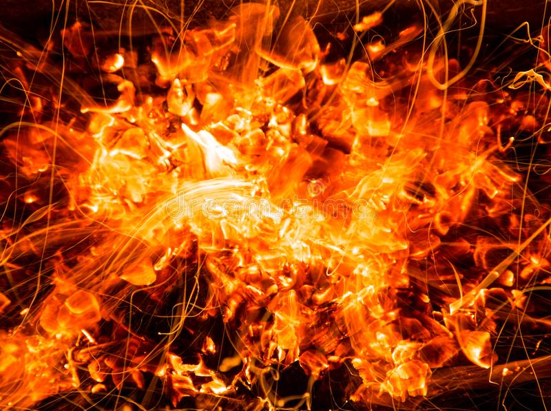 Abstract background of burning coals of fire with sparks royalty free stock images