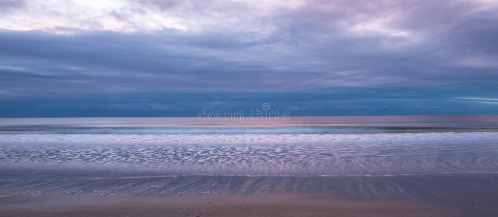 Abstract Background of Classic Blue and Turquoise Waves royalty free stock images