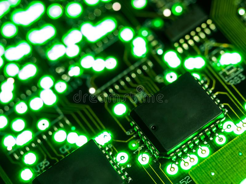 Abstract background,close up green circuit board. Electronic computer hardware technology. Mainboard computer background. Integrat. Ed communication processor royalty free stock photography