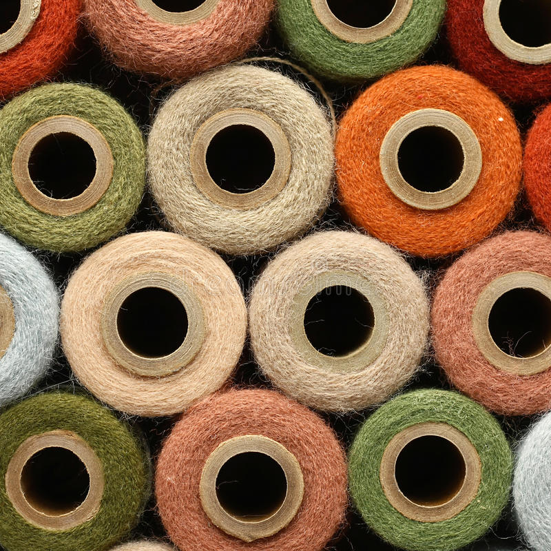 Abstract Background Collection of Antique Yarn Spools. An antique yarn spool collection is stacked together to create a colorful abstract circle background stock photo