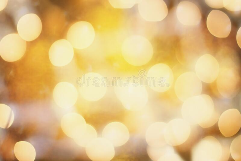 Orange and Gold Bokeh Lights Background. Abstract background of colored blurred orange and golden holiday lights bokeh circles for Halloween or Christmas royalty free stock photo