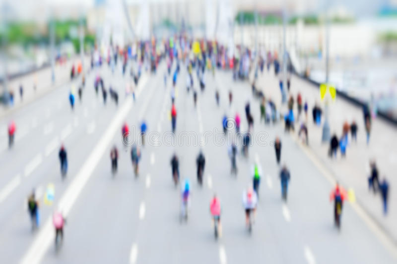 Abstract background of colored group of bicyclists in city center, bike marathon, blur effect, unrecognizable faces. Sport, fitness and healthy lifestyle royalty free stock photos
