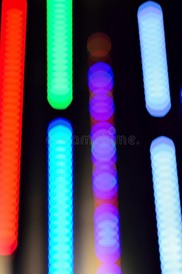 Abstract background of colorful blur light trails. In vertical frame stock photo