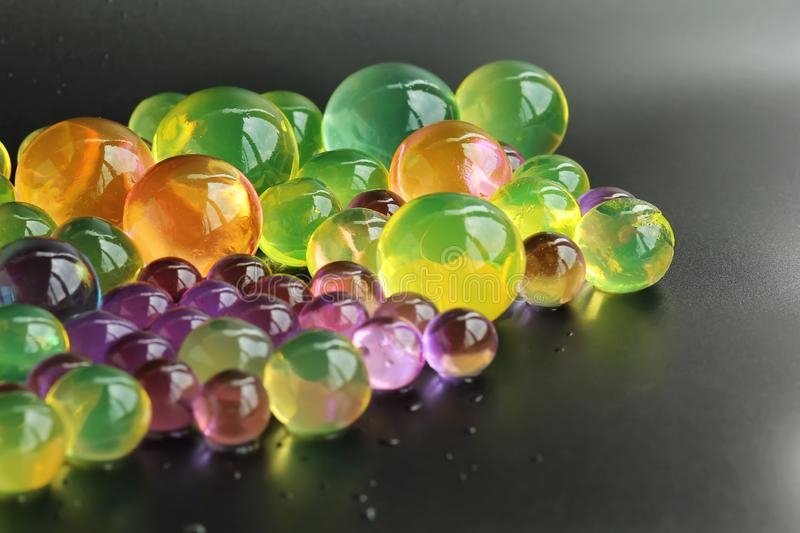Abstract background with colorful hydrogel orbeez balls royalty free stock photo