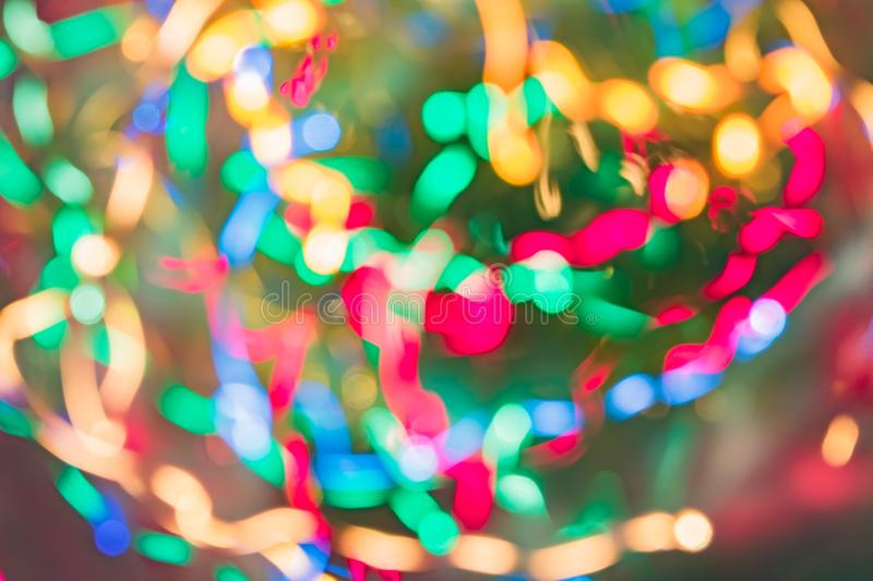 Abstract background of colorful lines in motion. blurred neon rainbow leds, festive backdrop of fireworks. Decocused image.  stock photography