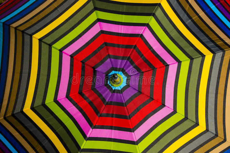 Abstract Background: Colorful Umbrella Pattern. Consecutively larger, bright, alternating colorful, sunlit octagon pattern in eight segments of an umbrella make stock image