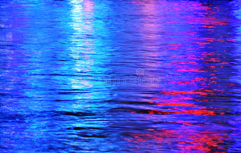 Abstract background colors rainbow colored multi-colored water. An abstract background image taken of the Brisbane city river at night with all the lights of the stock images