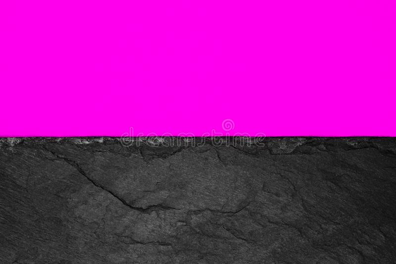 Abstract background composition of divided in the half vivid purple color paper and black stone with copy space stock photography