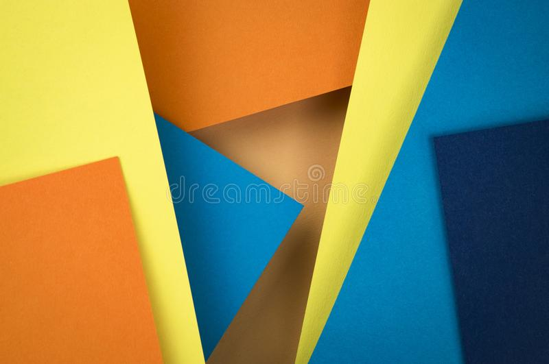 Abstract composition of blue and orange papers royalty free stock image