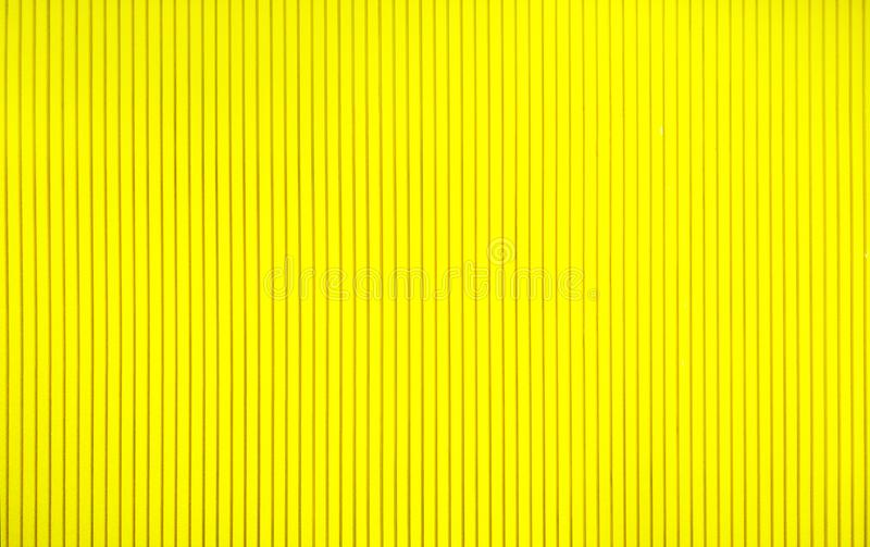 Abstract background concept,close up beautiful texture yellow wall and simple design of straight line for interior decorative stock images