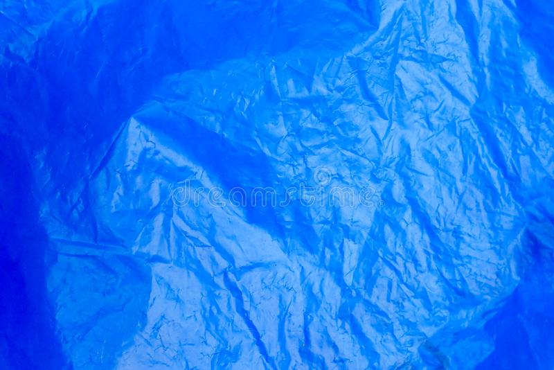 Abstract background crumpled plastic film texture blue garbage bag stock images