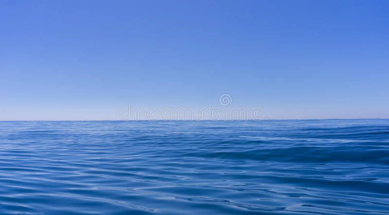 Abstract background deep blue oily looking surface of ocean stock images