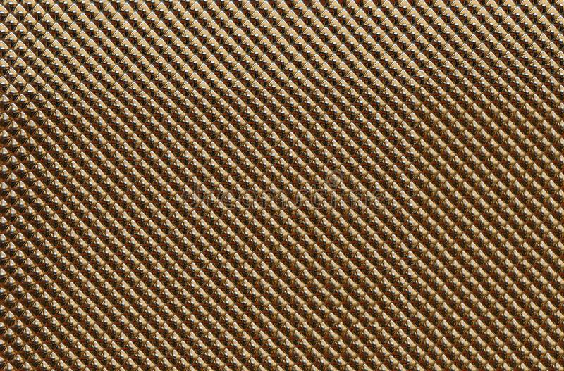 Abstract background with diamond-colored metallic gold texture and pattern. The image represents an abstract background with rhombus metallic gold texture and royalty free stock photos