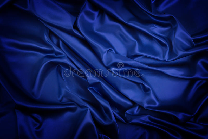 Abstract background, drapery blue fabric. Crumpled cloth, folds of fabric royalty free stock image