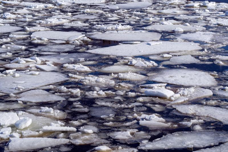 Abstract background of drifting ice on water. stock photos
