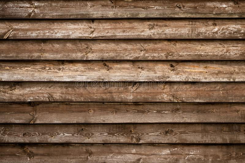 Abstract background. Empty space. Natural pattern. Art design. Grunge wall. Dark old brown wood texture. Shabby rustic fence. Wood. En boards of tree. Vintage stock photography