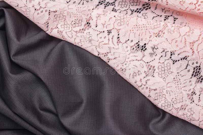 Abstract background, fabric texture of costume and lace pink. combination of fabric. Studio royalty free stock image