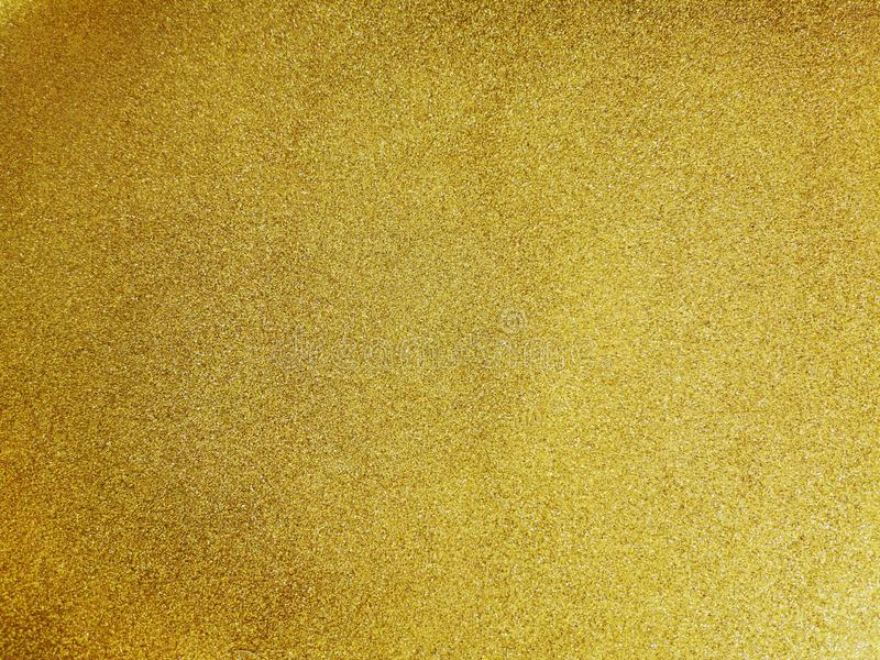 Abstract background of fine yellow gold dust stock images