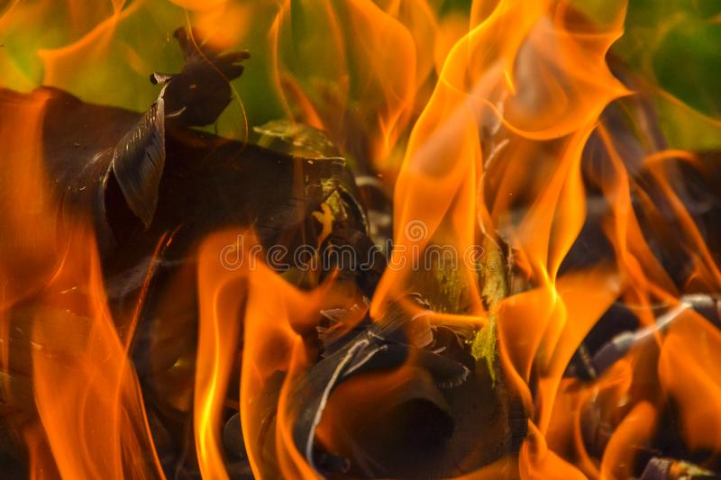 Abstract background of fire, coals, flames and twisting elements of ash stock images
