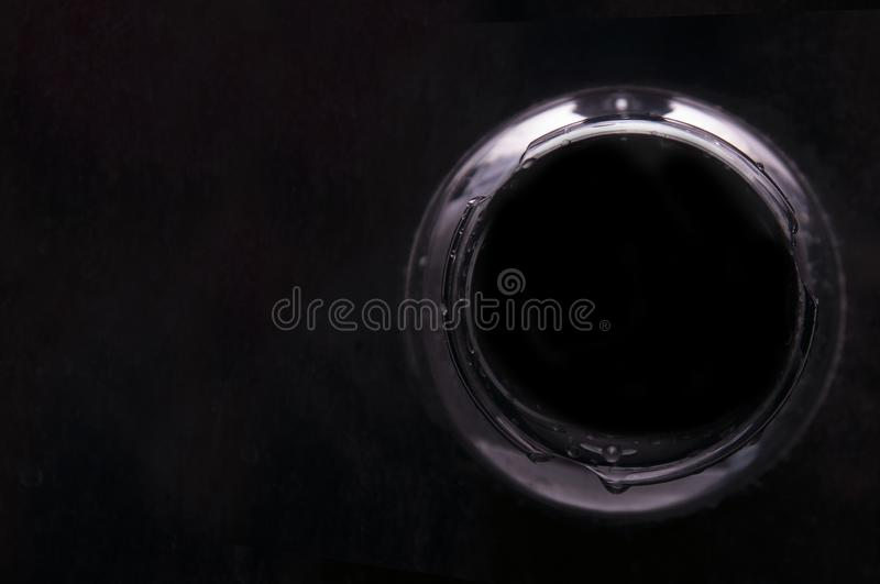 Abstract background in the form of a circle with a black hole inside on a dark background. stock images