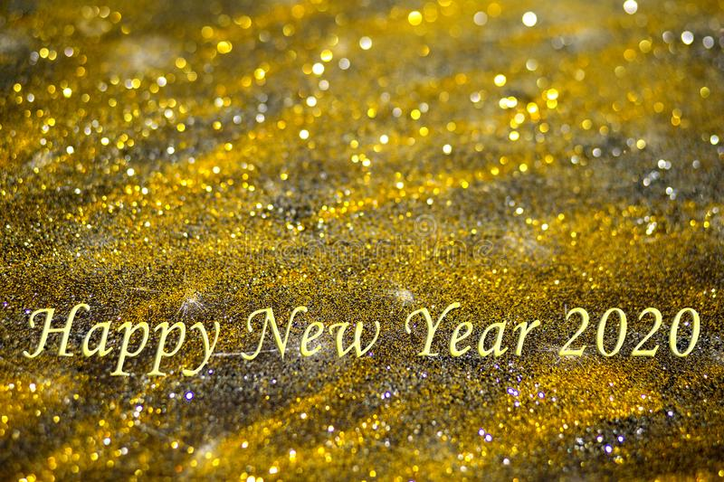 Words Happy New Year 2020 with golden glister bokeh background stock photos