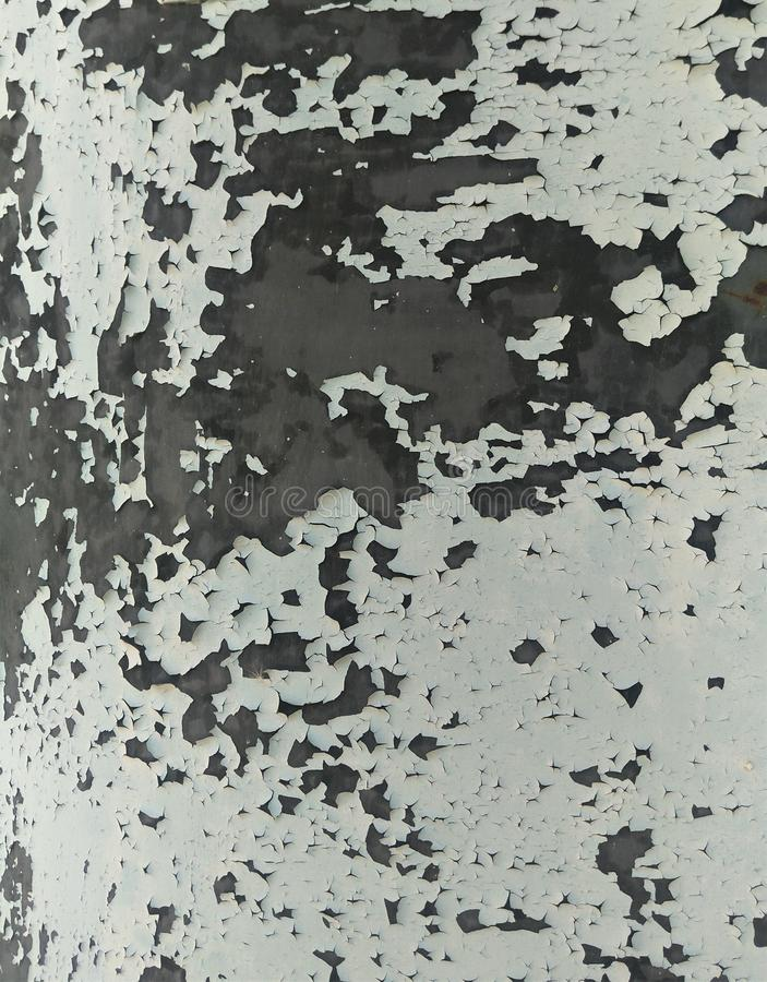 Abstract background of gray-blue craquelure of old oil paint.  royalty free stock images