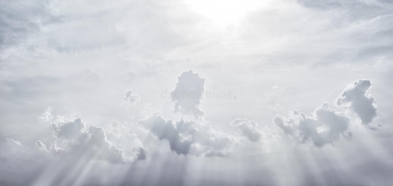 Grey sky with a special splash beam from the sun down royalty free stock photo