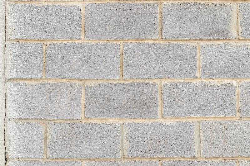 Abstract background of grey wall made of cinder blocks. Classic masonry blocks stock image