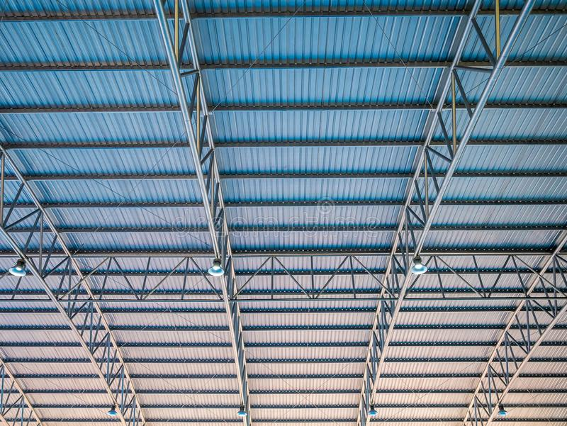 Abstract background high colorful blue and orange metal roof corrugated architecture . royalty free stock photo