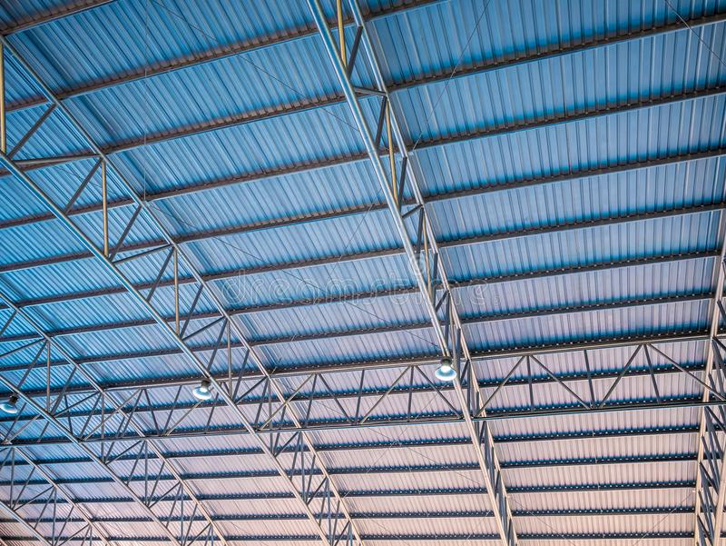 Abstract background high colorful blue and orange metal roof corrugated architecture . stock images