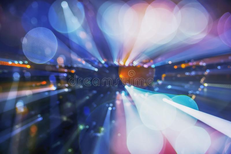 Abstract background image of circular bokeh motion blurred street light background of city, traffic light from car on street at n royalty free stock photos