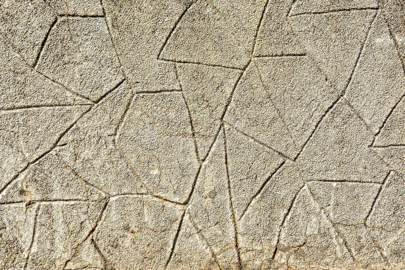 Abstract background imitation of an wall of stone. Texture of brown concrete masonry royalty free stock images